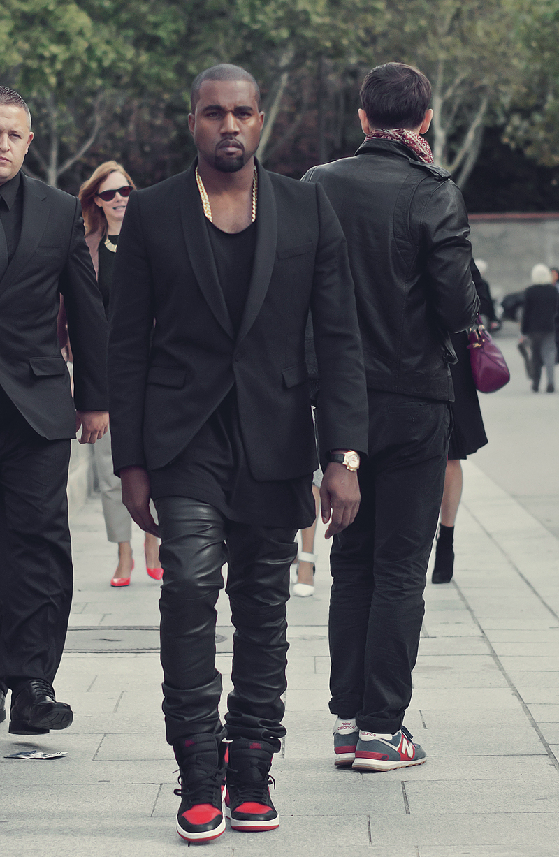 kanye west arrives at paris fashion week